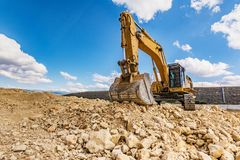 Big excavator moving earth in the construction works of a road. In Spain royalty free stock image
