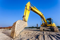 Big excavator on new construction site Stock Photography