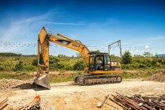Big excavator on new construction site, in the background the bl Stock Image