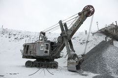 Big Excavator to load crushed iron ore, crushed stone, rocks. Royalty Free Stock Images