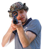 Big eye of aiming shooter in telescopic scope Stock Photo