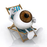 The big eye lying on beach chair Stock Images