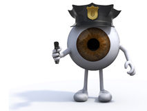 Big eye with police cop and gun on hand Stock Photo