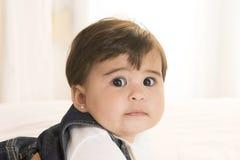Big eyed Baby Girl isolated on white background Stock Photos