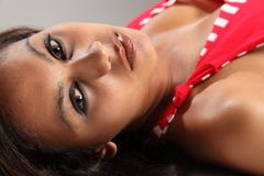 Big eyed beautiful young model lying down Royalty Free Stock Images