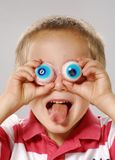 Big eyes. Little boy gesturing with false eyes,funny little Boy gesturing Stock Photo