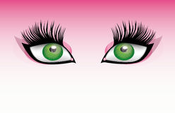 Big Eyes. Big cat eyes over a pink background Royalty Free Stock Photo