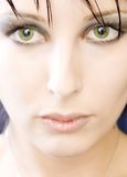 Big eyes. Woman with big green eyes stock photos