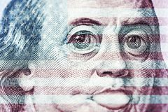 Big eyes of Benjamin Franklin with a hundred dollar bill, a symbol of inflation, appreciation, devaluation, close-up royalty free illustration