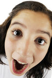 Big Eyes, Big Nose, Big Mouth!. Close-up, fisheye view of an opened-mouth young teen girl Royalty Free Stock Photo