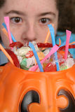 Big Eyes for Candy 1. A closeup shot of Halloween candy with a young girl's large eyes in the background. (focus is on candy royalty free stock images