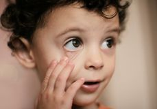 Big eyes, little girl. Little girl listening with open eyes Royalty Free Stock Photos