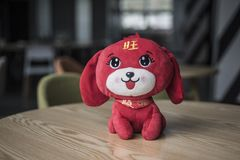 Big eyes, long ears, red fluffy toy dog. One on the table cute big eyes long ears red fluffy toy dog, illustration, background royalty free stock images
