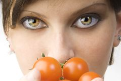 The big eyes and tomato royalty free stock photo