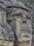 Big face devils head sculpted in 19th century by Vaclav Levy to. Big face devils head sculpted in 1846 by Vaclav Levy to the sand stone rock in Zelizy, czech Royalty Free Stock Image