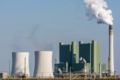 Large producing factory with cooling towers and chimney royalty free stock photos