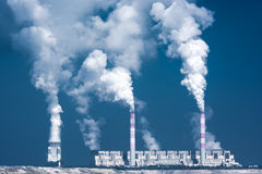 Big factory with smoky chimneys Royalty Free Stock Images