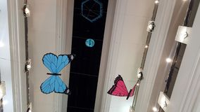 Big fake butterfly in the hall in shopping mall Royalty Free Stock Photo