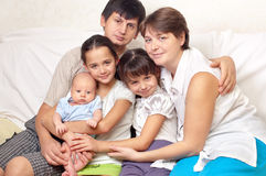 Big family. Home on the couch Royalty Free Stock Photo