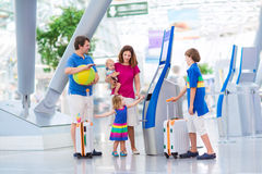 Big family at the airport. Big happy family with three kids travelling by airplane at Dusseldorf International airport, parents with teenager boy, toddler girl Stock Images