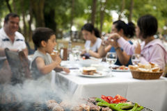 Big Family Barbecue in the Garden Stock Photo