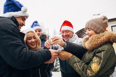 Big family celebrating New Year and Christmas. Big family celebrates the new year on the street,snowman,family concept Stock Images