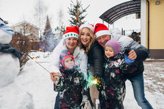 Big family celebrating New Year and Christmas. Big family celebrates the new year on the street,snowman,family concept Royalty Free Stock Photo