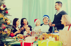 Big family with children celebrates Christmas. At table in home stock photos