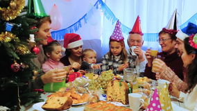 A big family during Christmas dinner. Large family happy to see each other during Christmas dinner stock video footage
