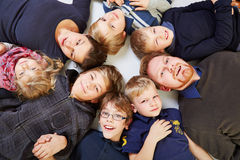 Big family in a circle. Big family with six kids in a circle looking up Stock Photography