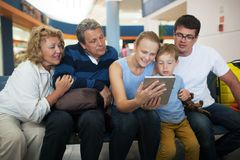 Big family entertaining with touch pad at the Royalty Free Stock Photo