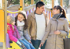 Big family of four resting at children slide royalty free stock image