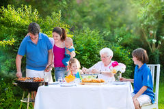 Big family grilling meat for lunch Royalty Free Stock Photo