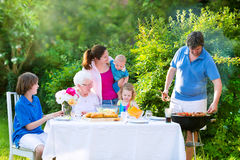 Big family grilling meat for lunch Royalty Free Stock Images