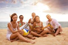 Big family having fun at the beach. Big happy family is having fun at sunset beach Stock Photos