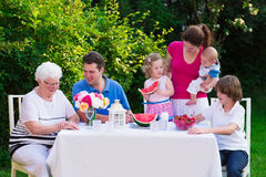 Big family having lunch outdoors stock image
