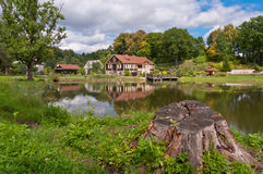 Big Family House in Front of the Lake in the Forest Royalty Free Stock Images