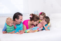 Big family with kids in bed Royalty Free Stock Images