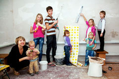 Big family making repairs to their new home. stock photography