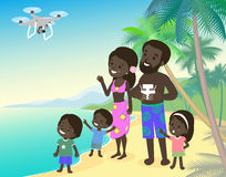 Big family mom dad and three children kids boy girl on vacation seashore ocean sea with quadcopter drone african indian Stock Image