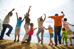 Big family party on the beach. Big family from  adults and children dancing on the beach Royalty Free Stock Image