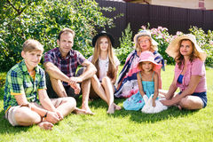 Big family relaxing in the summer park Stock Photo