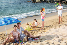 Big family resting on beach royalty free stock photo