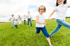 Big Family Running Stock Image