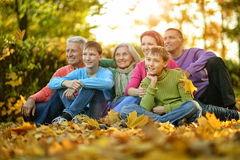 Big family sitting on ground royalty free stock photography