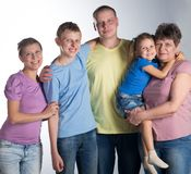 Big family  in the studio. Elderly woman with grown-up daughter, son and grandchildren, in the studio. Big family royalty free stock photo