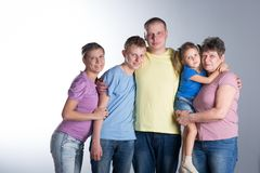 Big family  in the studio. Elderly woman with grown-up daughter, son and grandchildren, in the studio. Big family royalty free stock photos