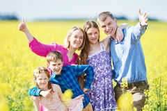 Big family in summer field outdoors. Stock Photo