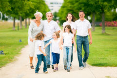 Big Family Walking Through The Park. Enjoying summer Royalty Free Stock Photo