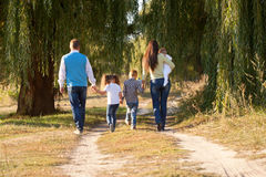 Big family walking in the park. Stock Images